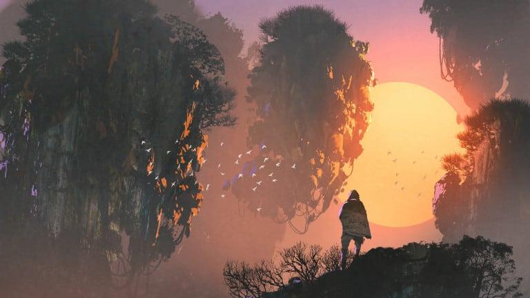 Une personne devant des îles volantes sous un coucher de soleil